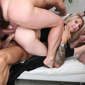 Sporty milf Sindy Rose welcomes three big cocks in her ass