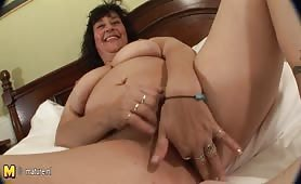Dark haired granny touching her old cunt